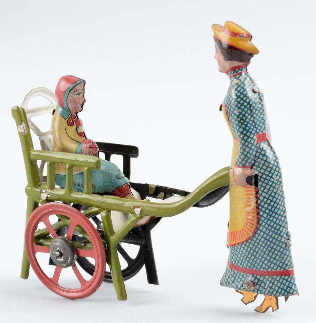 German Tin Litho Nanny Pushing a Child Penny Toy. - 2