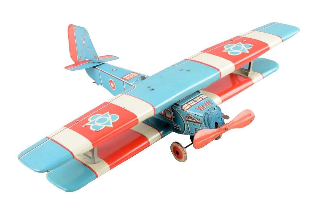 European Made Tin Litho Wind-Up Bi-Wing Airplane Toy.