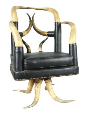 Horned Armchair With Black Upholstery.