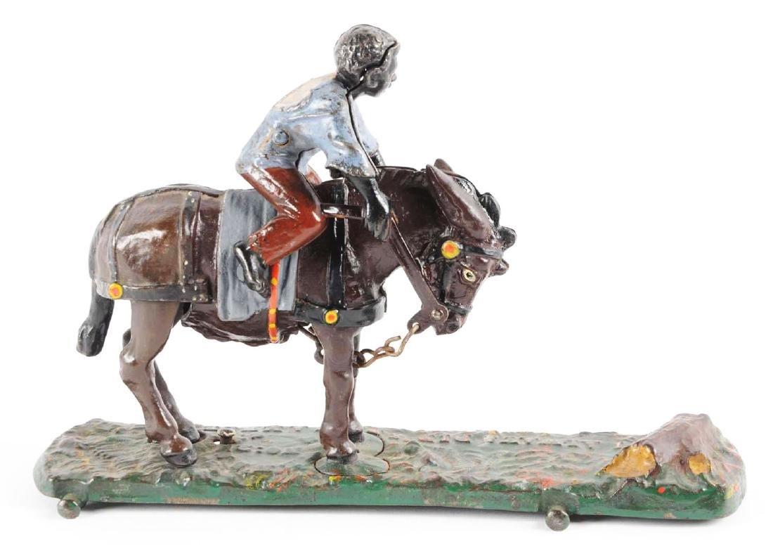 J. & E. Stevens Jockey over Toy. - 2