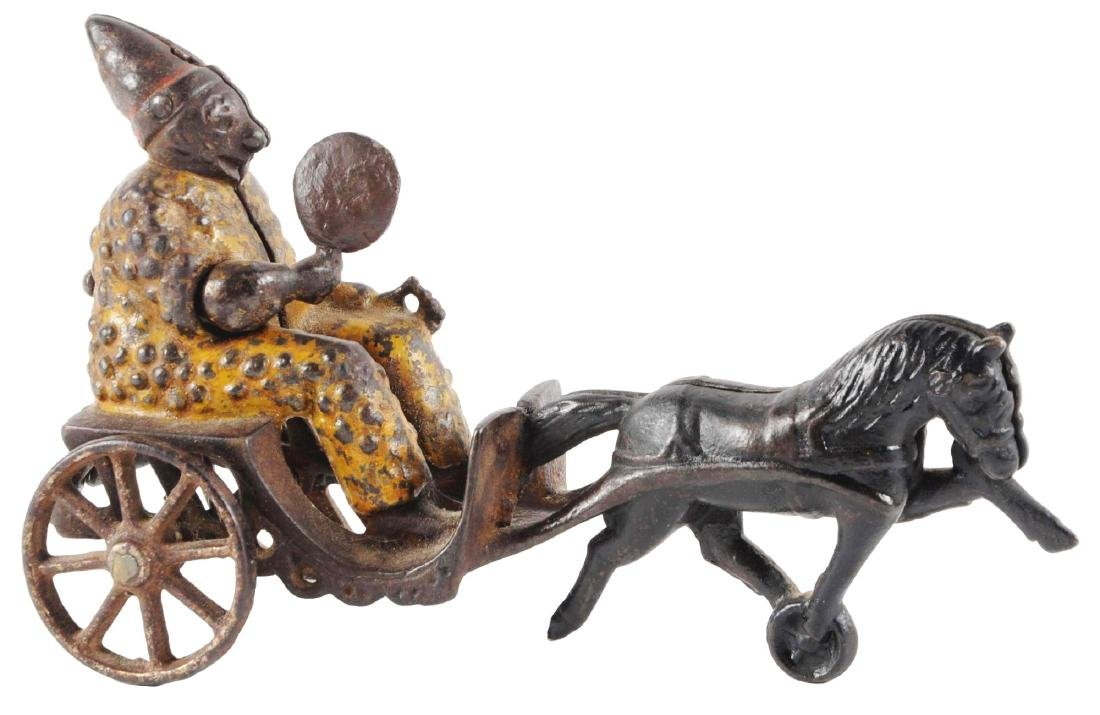 Cast Iron Fanning Clown Pull Toy.