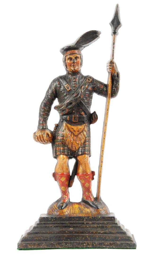 Cast Iron Highland Warrior Doorstop.