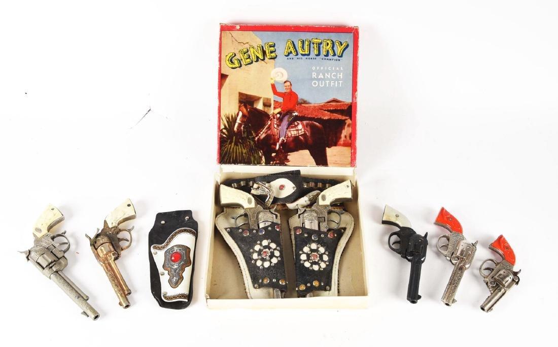 Lot of 7: Gene Autry Cap Guns.