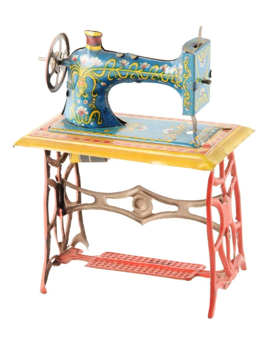 German Fischer Tin Litho Sewing Machine Penny Toy.