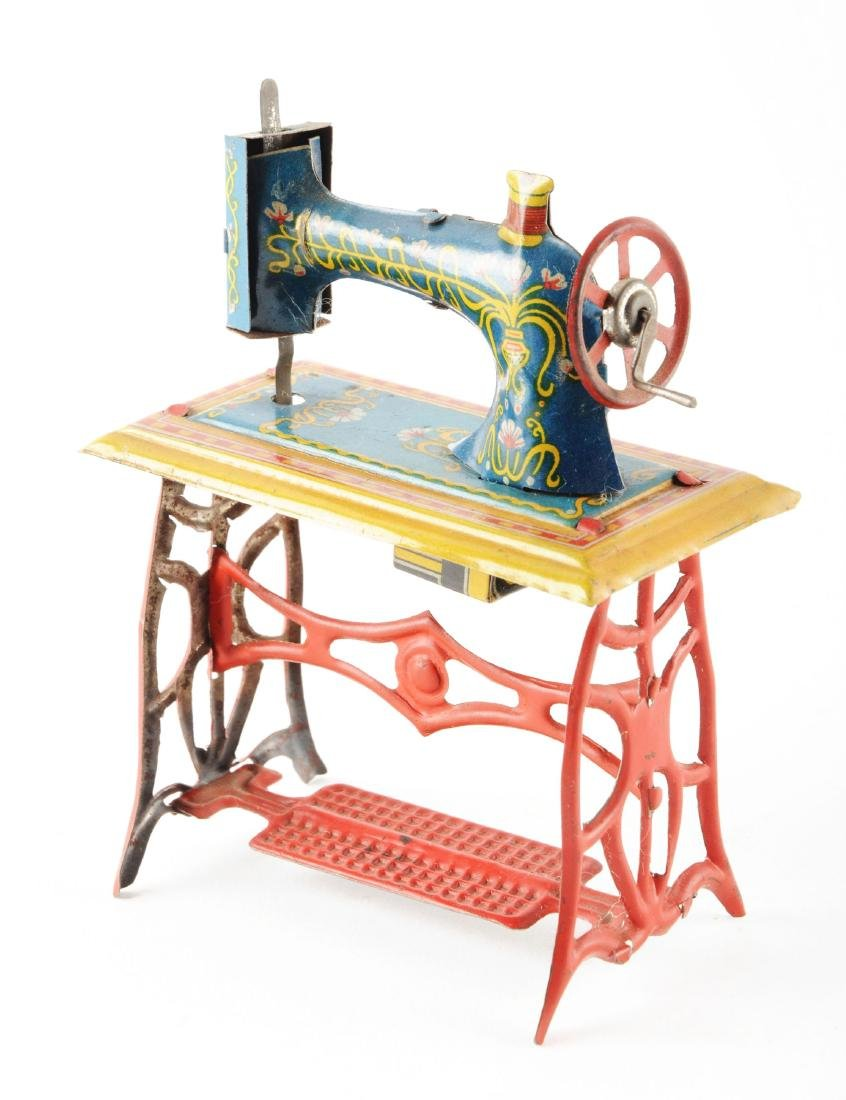 German Fischer Tin Litho Sewing Machine Penny Toy. - 2