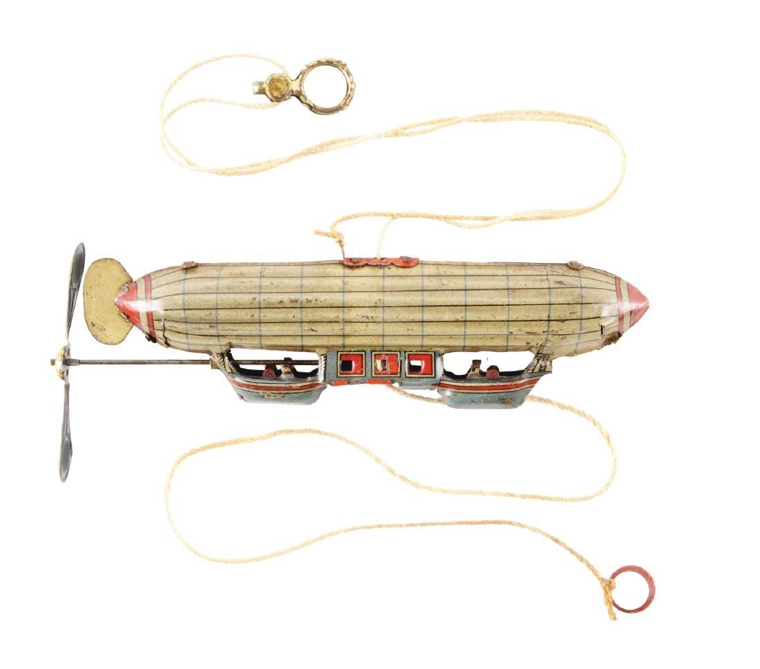 German Tin Litho Zepplin Penny Toy.