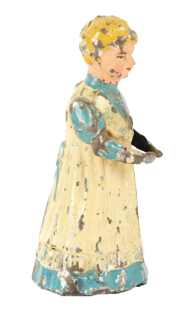 German Hand Painted Wind Up Tin Walking Woman.