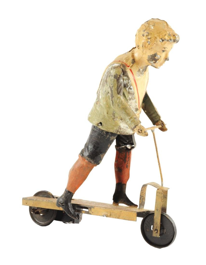 German Hand Painted Wind Up Boy Riding Scooter.