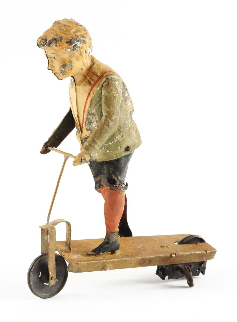 German Hand Painted Wind Up Boy Riding Scooter. - 2