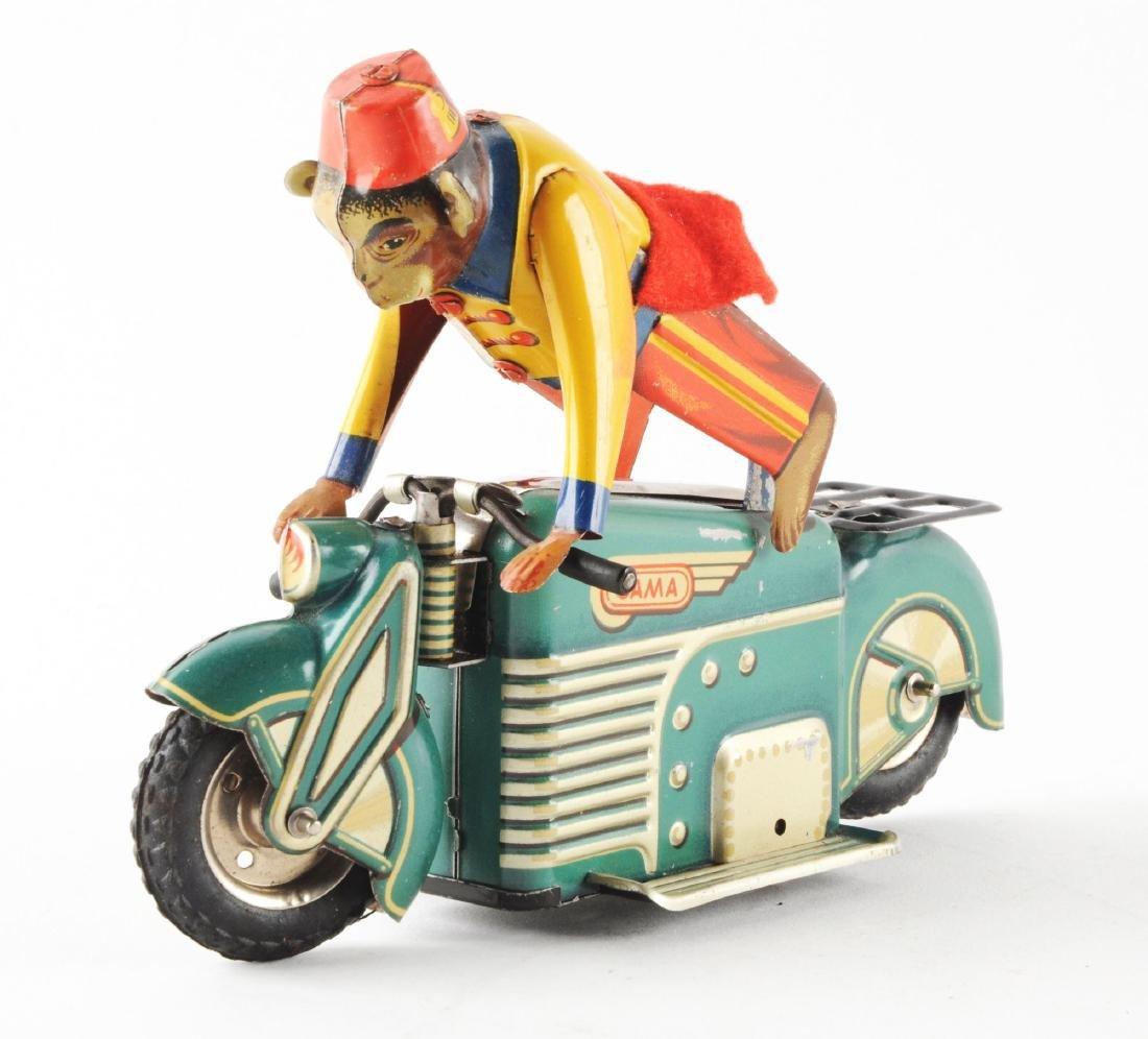 German Tin Litho Gama Motorcycle with Monkey. - 2