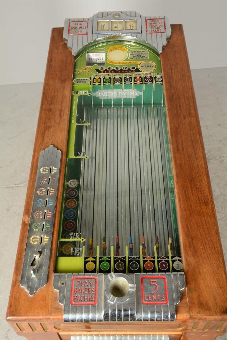 **5¢ Baker's Pacers Console Slot Machine. - 7