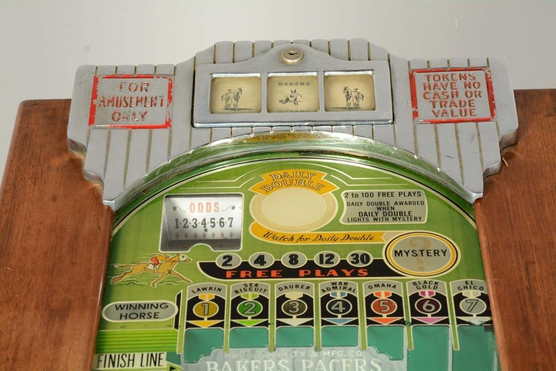 **5¢ Baker's Pacers Console Slot Machine. - 8