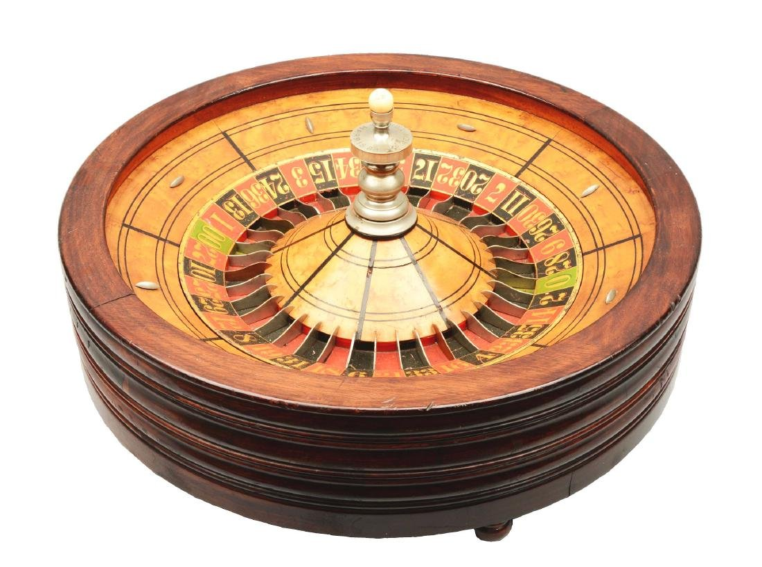 Table Top Mahogany Roulette Wheel.