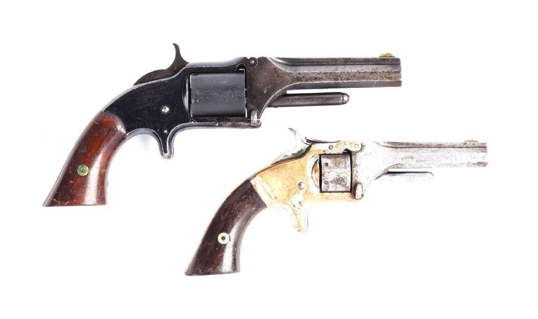 (A) Lot of 2: S&W Tip-Up Spur Trigger Pocket Revolvers.