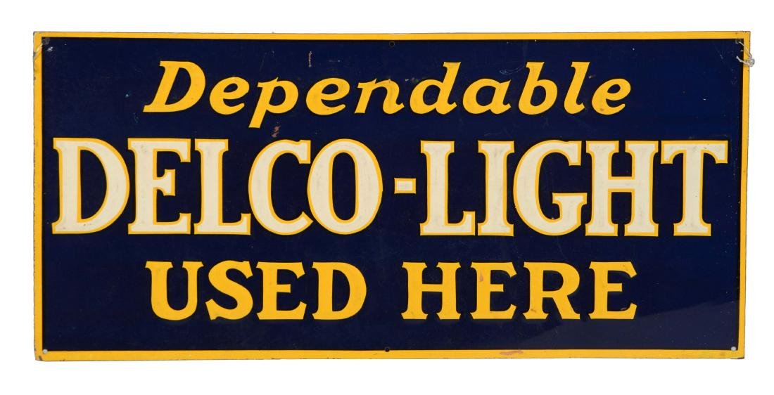 Dependable Delco Light Used Here Embossed Tin Sign.