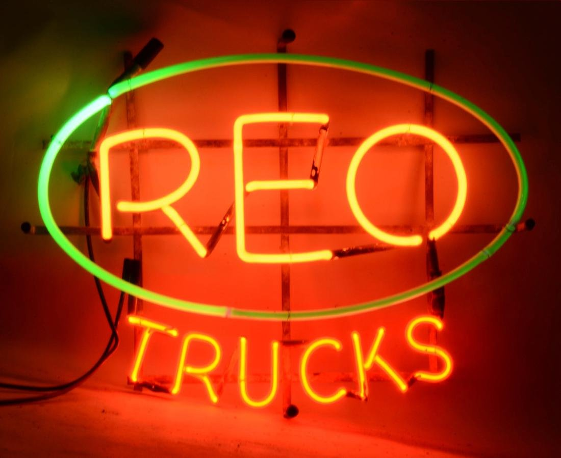 REO Trucks Neon Sign On Original Metal Hanging Rack.