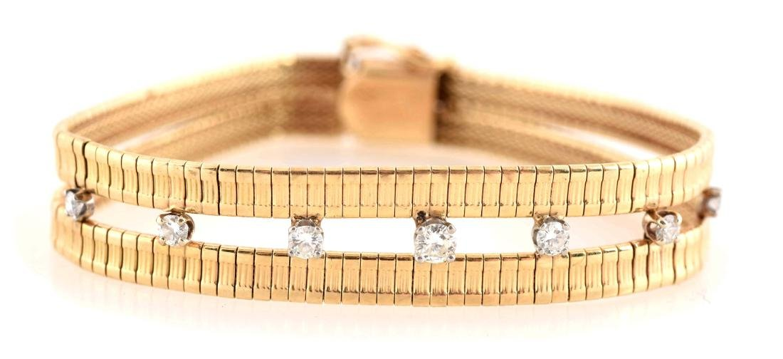 14K Gold Bracelet with Seven Small Diamonds.