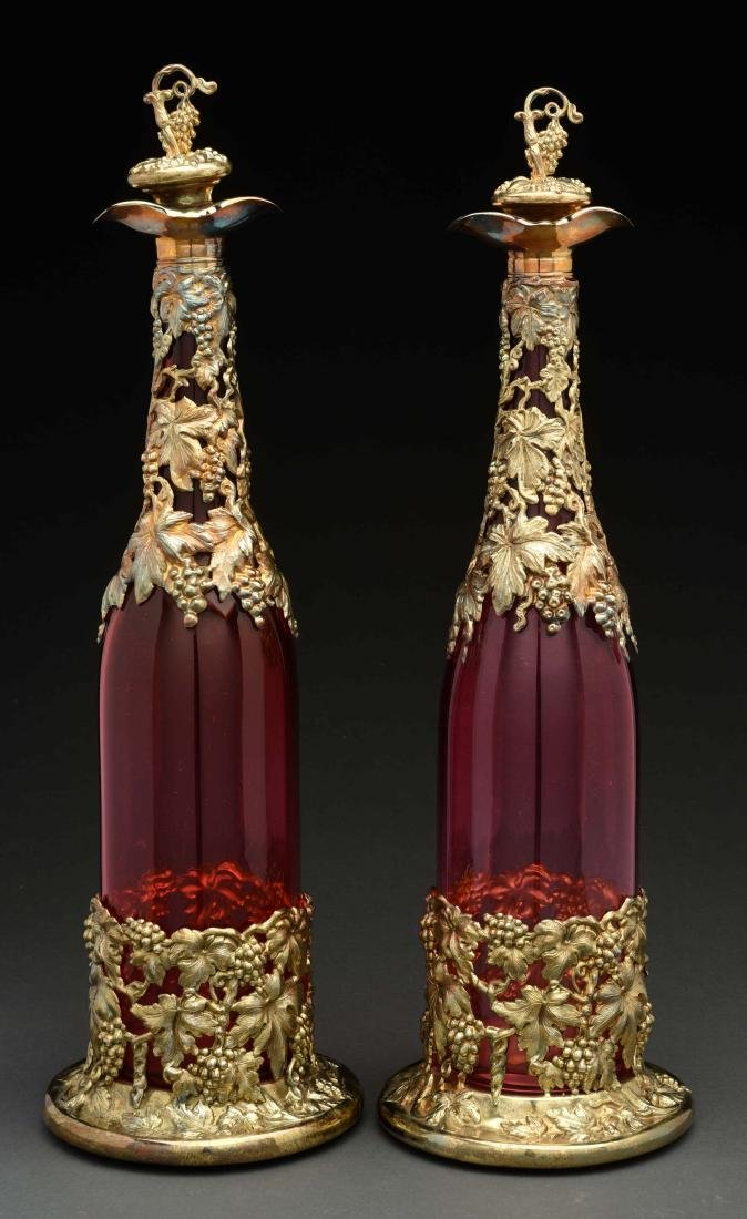 Pair Of Ruby Glass Decanters.
