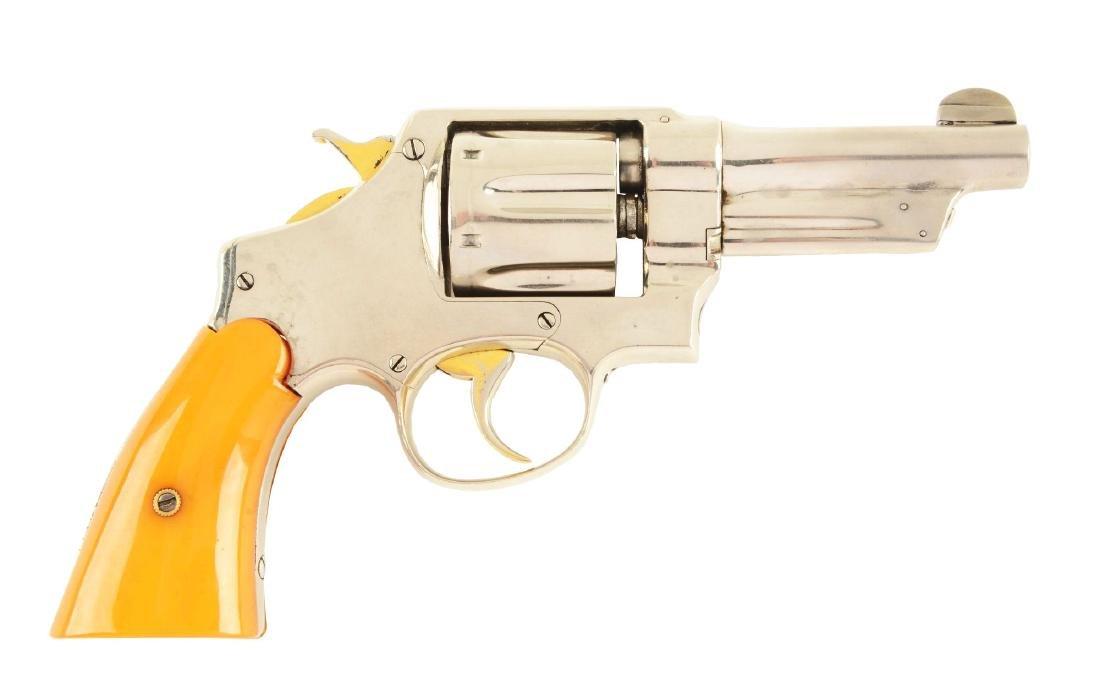 (C) S&W Triple Lock Revolver.