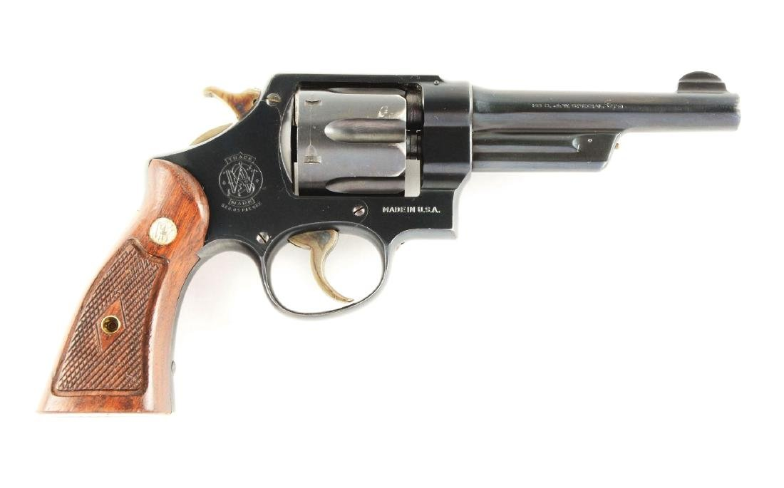 (C) S&W .38-44 Heavy Duty Revolver (1946).