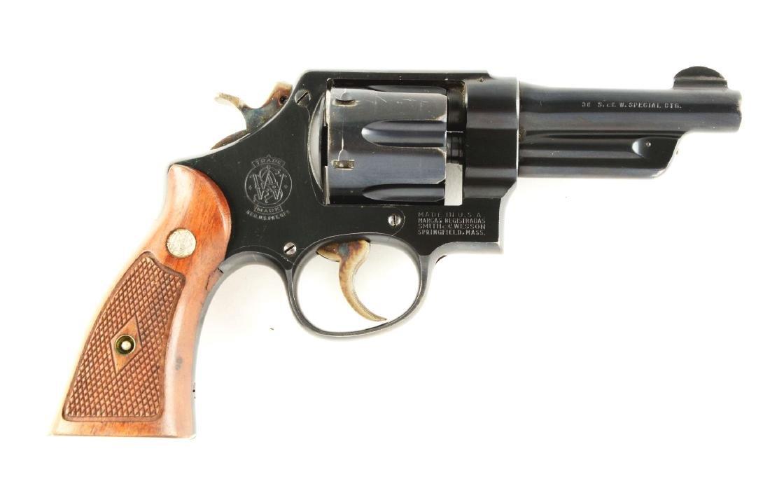 (C) S&W .38-44 Heavy Duty Revolver.