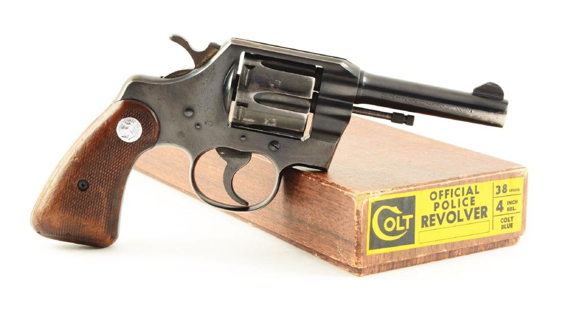 (C) Boxed Colt Official Police Double Action Revolver.