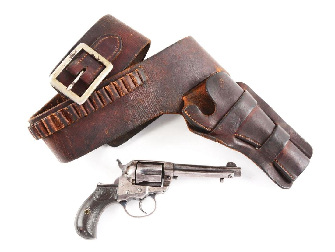 "(A) Colt Model 1877 ""Thunderer"" Double Action Revolver."