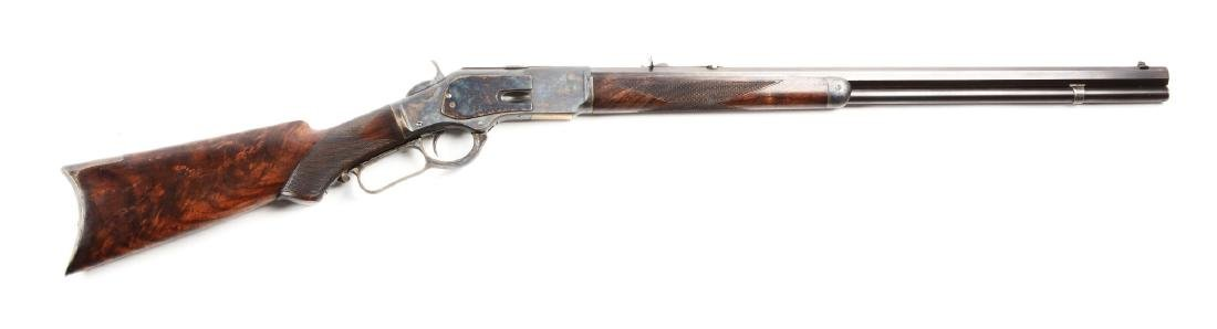 (A) Winchester Deluxe Model 1873 Lever Action Rifle.