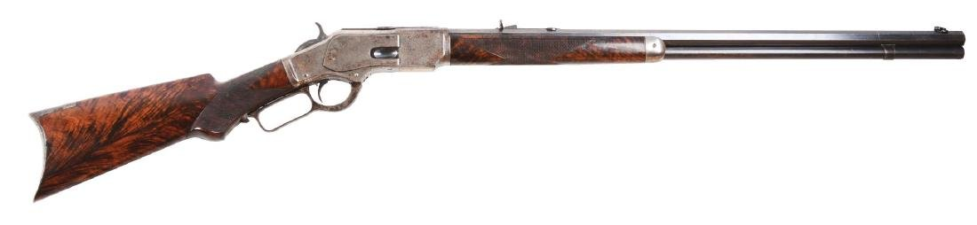 (A) Winchester Model 1873 Deluxe Lever Action Rifle.