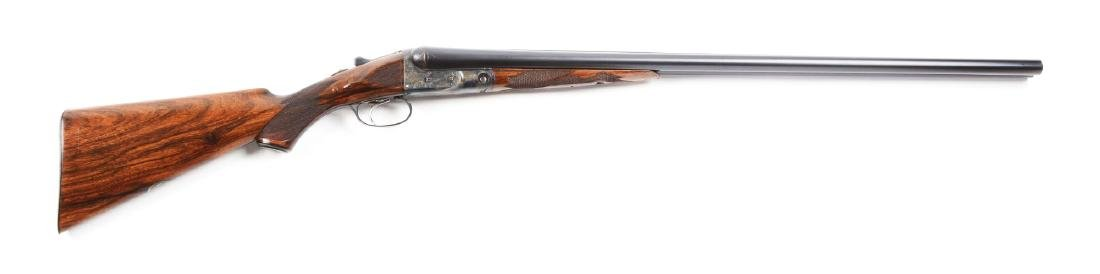 (C) Parker DHE Grade 12 Bore Double Barrel Shotgun.