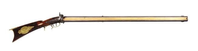 (A) Swivel Breech Percussion Kentucky Rifle by Shuler.
