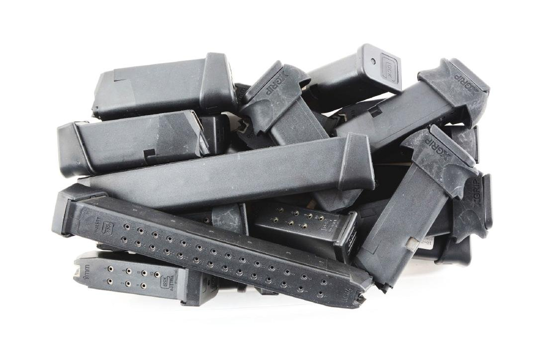 Lot of 24: Glock Magazines.