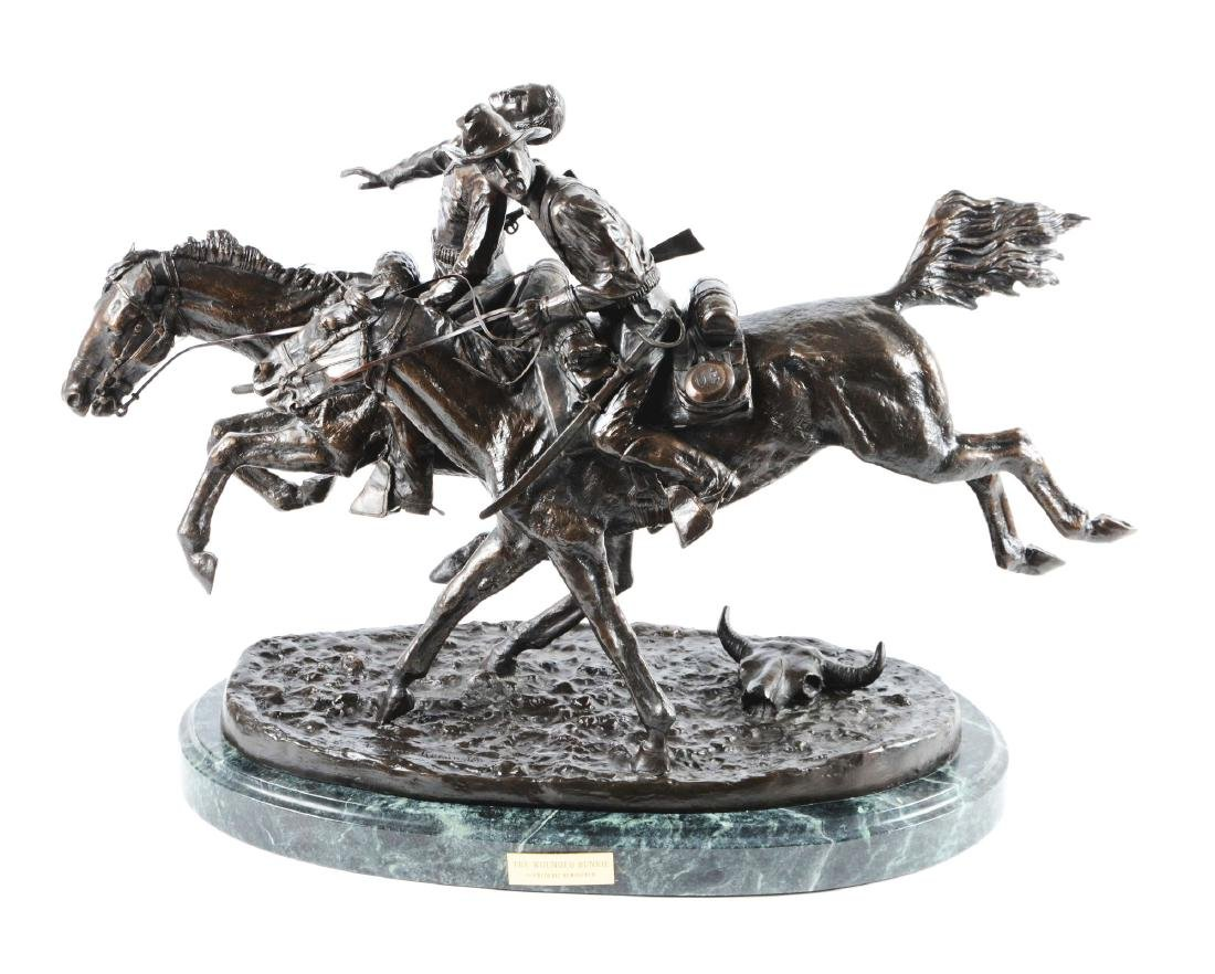 """Frederick Remington """"Wounded Bunkie"""" Bronze Statue."""