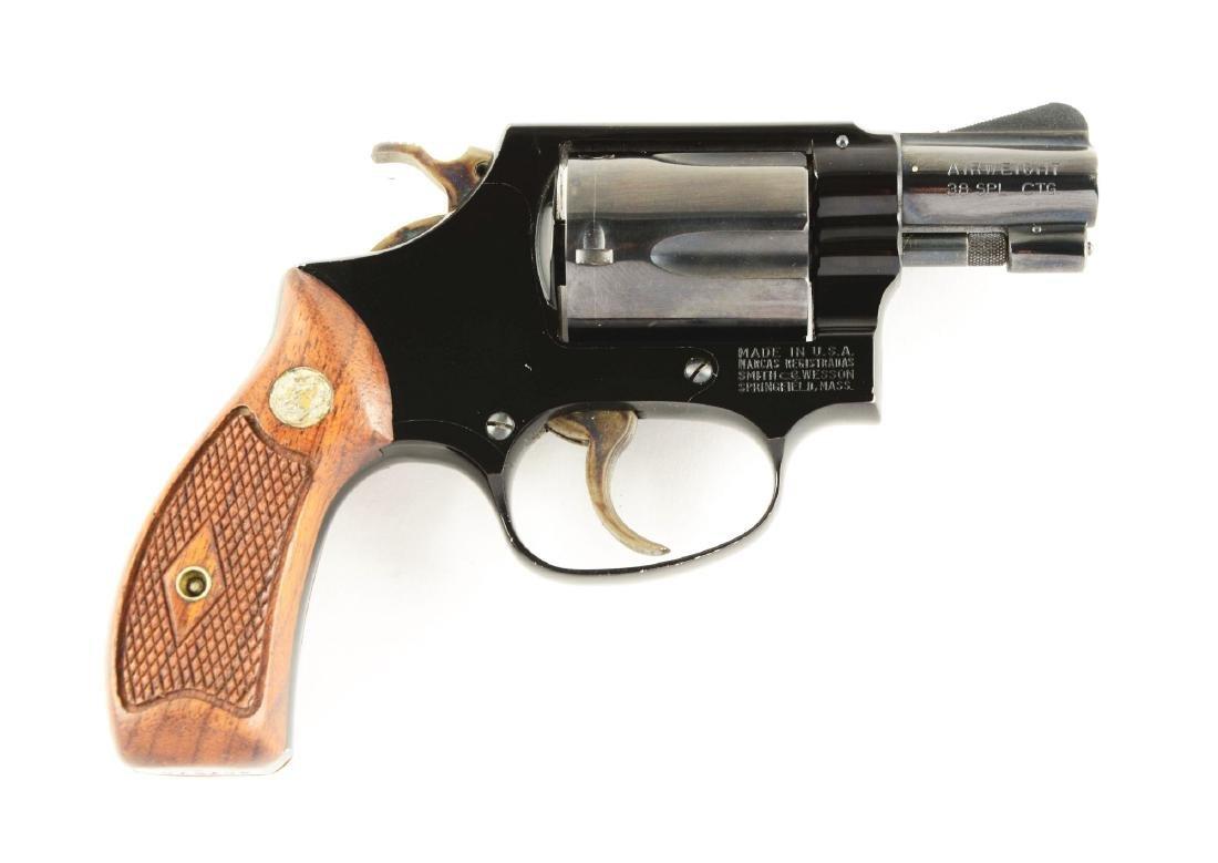 (C) S&W Flat Latch Model 37 Airweight Revolver.
