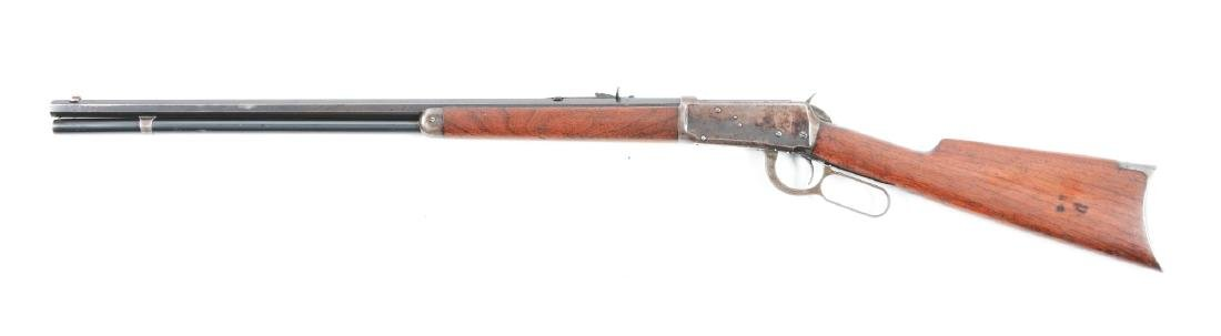 (C) Winchester Model 1894 Lever Action Rifle (.32-40). - 2