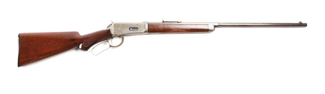 (C) Winchester Model 1894 Deluxe Lever Action Rifle.