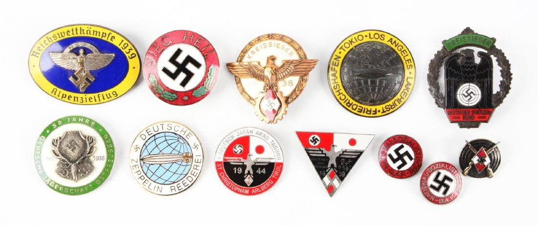 Lot of 12: Assorted Nazi Pins & Badges.