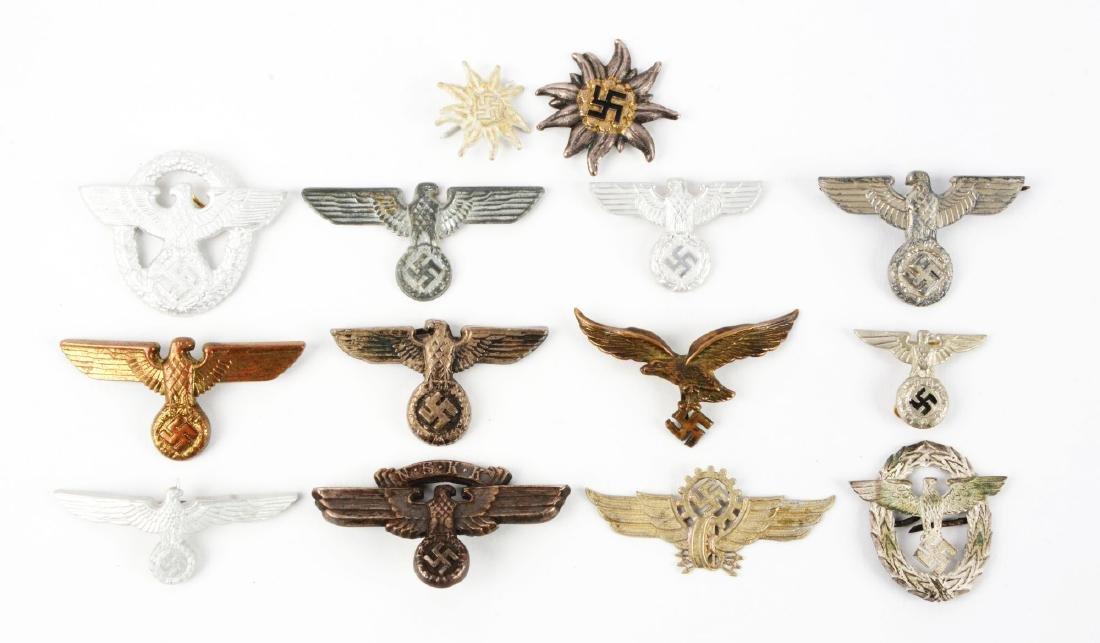 Lot of 14: Assorted German World War II Cap Badges.