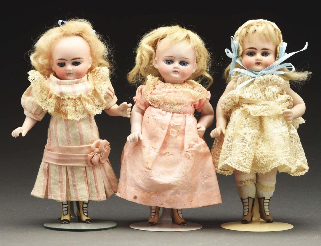 Lot of 3: German All Bisque Dolls.