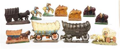 Lot of 8: Cast Iron Covered Wagon Doorstops & Bookends.