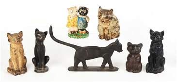 Lot of 7: Cast Iron Cat Doorstops.