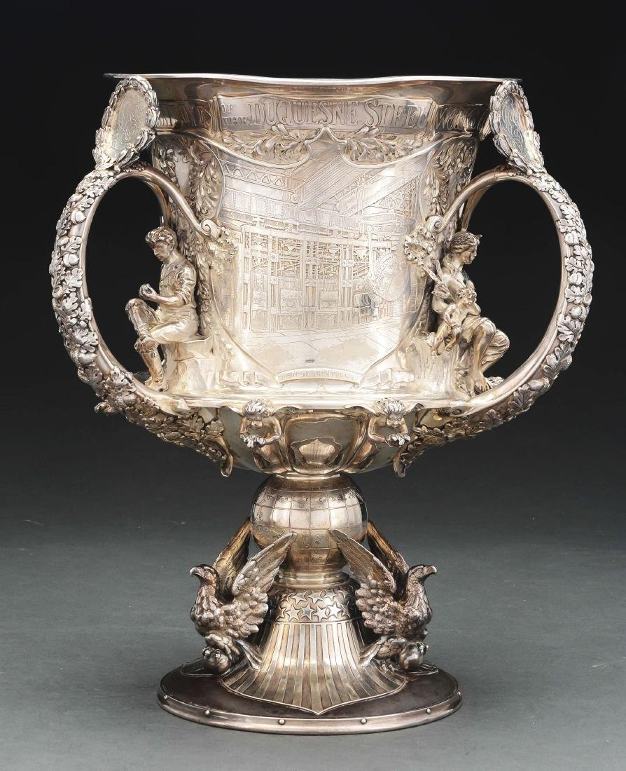A Tiffany Sterling and Steel Three Handled Cup.