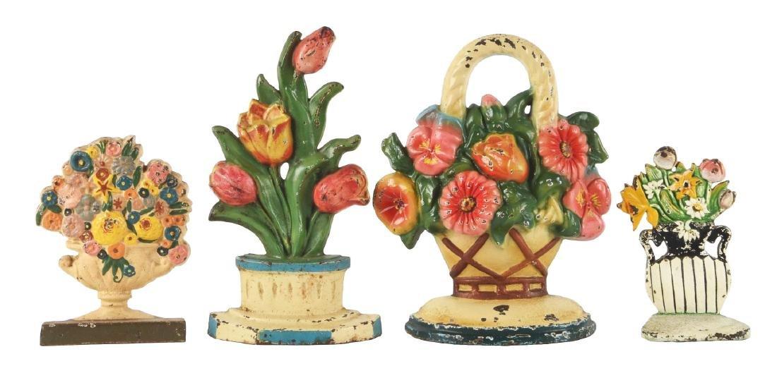 Lot Of 4: Cast Iron Assorted Flower Doorstops.