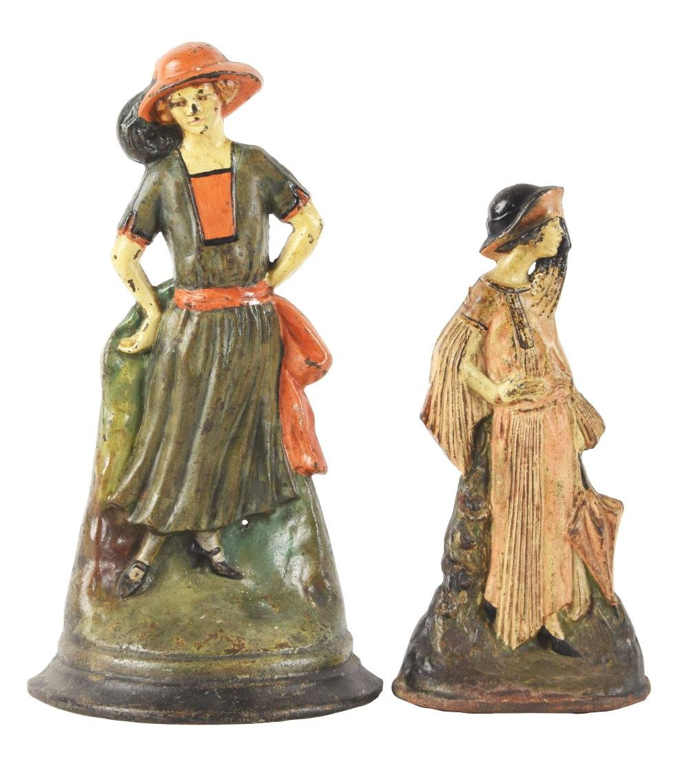Lot Of 2: Cast Iron Figural Lady Doorstops.