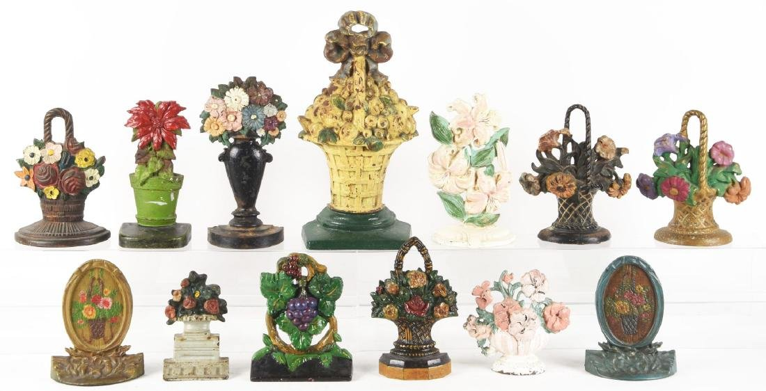 Lot of 13: Assorted Cast Iron Flower Doorstops.