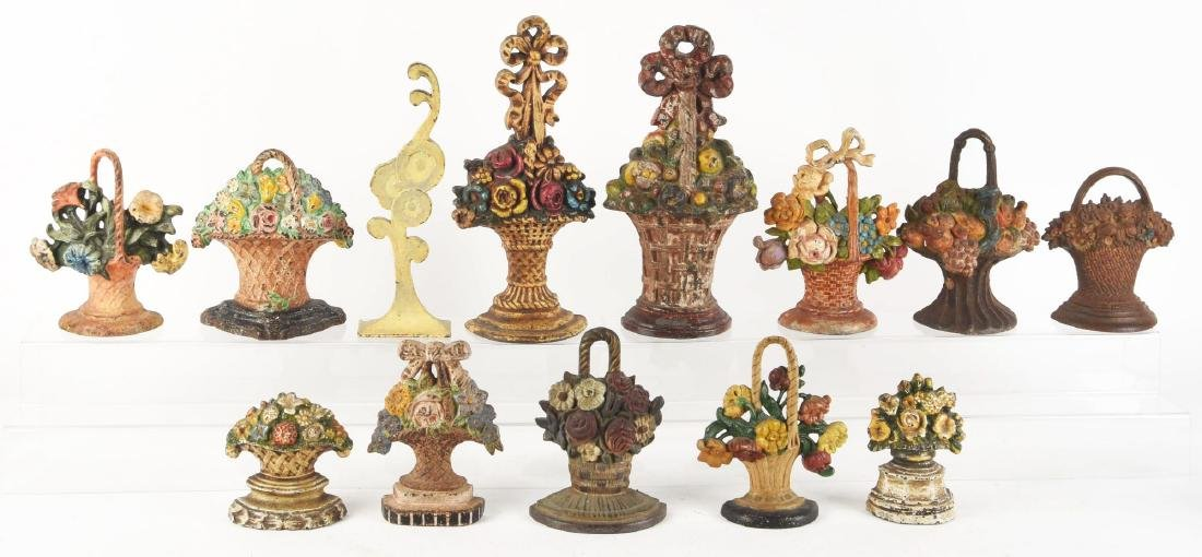 Lot of 13: Cast Iron Assorted Flower Doorstops.