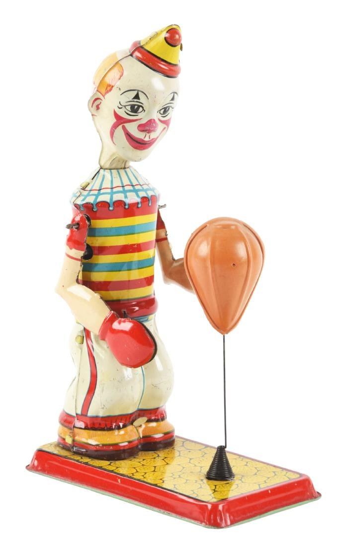 Chein Tin Litho Wind-Up Clown Puncher Toy.
