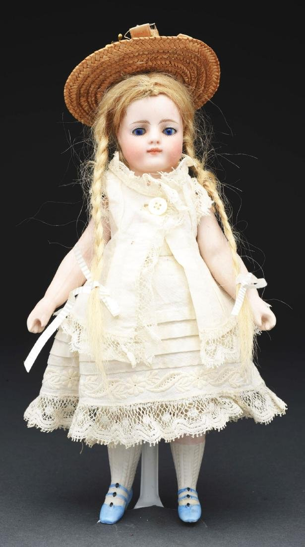 French All Bisque Mignonette Doll with Blue Shoes.