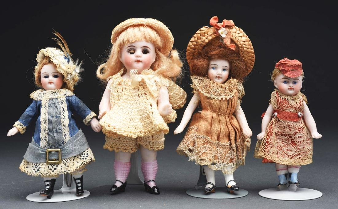 Lot of 4: German All Bisque Dolls.