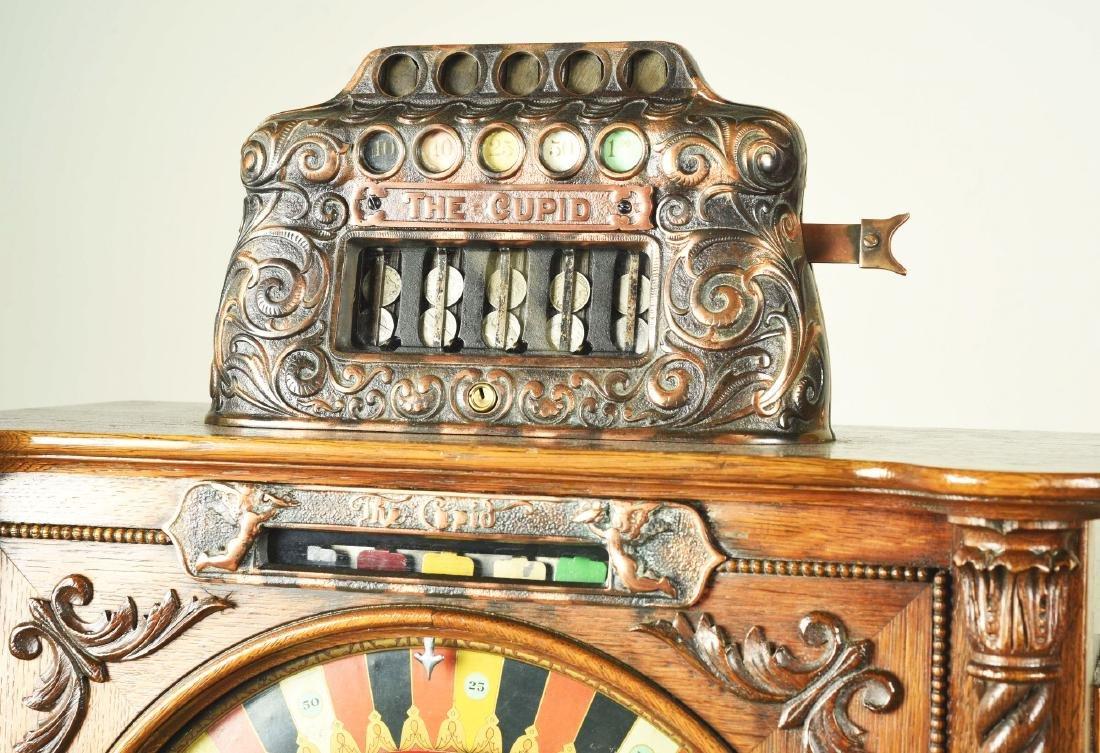 **5¢ Watling Mfg. Co. Cupid Upright Slot Machine. - 5
